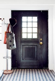 Door, clothes stand & hallway tiles
