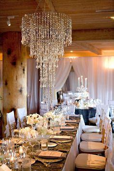 Stunning chandelier over dining table set for dinner