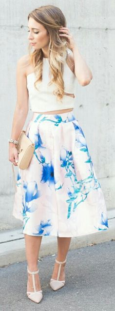 A simple white tank top with a lovely blue floral skirt. Pair with baby pink heels and a floral headband and you are done