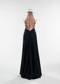 """Black wool and gold lamé """"From the Arabic"""" evening ensemble (back, without jacket) by Elizabeth Hawes, American, fall/winter 1939."""