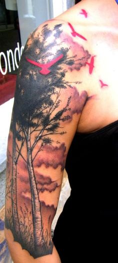 Tree tattoo. Love the red silhouettes.