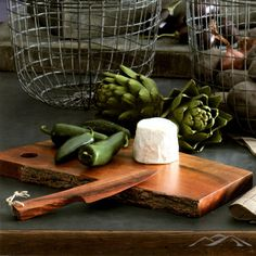 Bark Edge Cutting Board. Rosewood Knife. The bark edge of the handsome acacia wood is left partially intact on this cutting board to add natural and rustic textural detail. Pair with our hand-carved rosewood knife for serving soft cheese or pate in organic style.