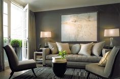 Glossy-Townhouse-Interior-Design-Idea-For-Living-Room-With-White-Desk-Lamps-Gray-Sofas-With-White-Throw-Pillows-And-Gray-Wall-Beautiful-Townhouse-Interior-Design-Ideas-1220x808.jpg 1,220×808 píxeles