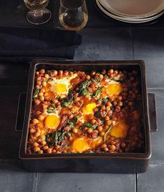 Australian Gourmet Traveller Spanish recipe for baked eggs with chickpeas and spinach.