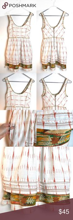 """Free People New Romantics Embroidered Dress Free People New Romantics Embroidered Dress. Sleeveless dress with 1"""" strap. 33.5"""" from shoulder to hem. Tiered skirt with pockets. Zip-up back. Lightly worn and in good condition. Beautiful embroidered detail. Size 4 Free People Dresses"""