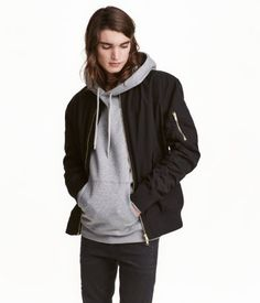 Black. Bomber jacket in woven cotton fabric. Ribbed stand-up collar, gathered sleeves with concealed elastication at seams, and zip at front. Side pockets
