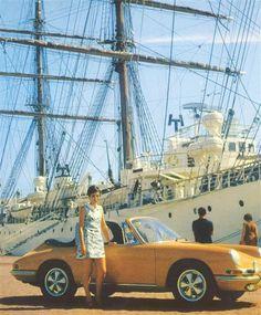Orange Porsche 911, lady and ship