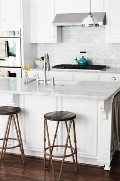 awesome kitchen. rustic kettle. marble tiles.