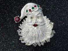 Fantastic 1950s Santa Claus pin with white enamel accented with gold flecking. Accented with clear, green and red rhinestones. Perfect office