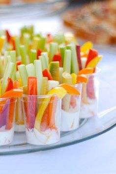 Serve up these adorable No-Mess Veggies and Dip as a midday snack for your family. These brightly colored vegetables are sure to be a hit!