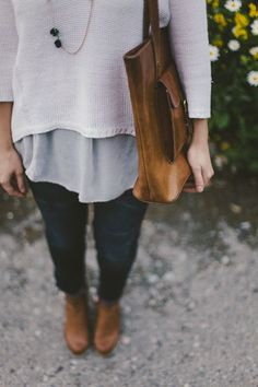 loose neutral sweater, leather bag, books with jean // the messes of men