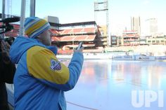 St. Louis Blues goatender Jake Allen stops to take a photo of the new ice rink installed inside Busch Stadium in St. Louis on December 29,…