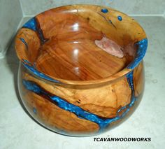WOOD BOWL hand turned plum wood inlaid with blue and pink pearl resin. $250.00, via Etsy.