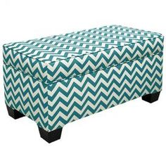 Inspired by cozy abodes and soothing hues, this beautifully crafted design transforms your home into a well-appointed retreat.    Product: Storage bench  Construction Material: Fabric  Color: Turquoise and white    Features:  Luxurious, beautiful and functional style    Convenient lift off top   Upholstered in a trendy, eye-catching pattern     Dimensions: 18 H x 36 W x 18 D      Note: Assembly required  Cleaning and Care: Spot clean only