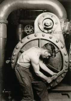 Lewis Hine, Powerhouse Mechanic.  I'm really starting to get into black and white photography and this is one of the classic images I really love.  There are three versions of this image, each composed very slightly differently but this seems the least 'staged' (although a model was hired and brought into the factory!