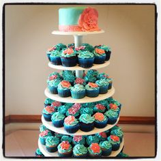 Teal & Coral Wedding Cupcake Tower...love the idea of having a small cake for the bride and groom on top