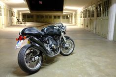 Black SportClassic 1000 with black Zard slip on pipes and tail chop. Nice and simple :)