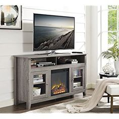 Walker Edison Furniture Company Transitional Fireplace Glass Wood TV Stand Entertainment Center - Driftwood - The Home Depot Swivel Tv Stand, Tv Stand Console, Console Table, Home Depot, Highboy Tv Stand, Electric Fireplace Tv Stand, Electric Fireplaces, Tv Stand With Fireplace, Cool Tv Stands