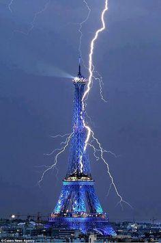 Lightening weaves it's way thru Eiffel Tower.