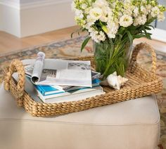 Eco-Friendly Home Accents Under $50: Keep your coffee table styled yet relaxed using this straw tray ($39).   Would be perfect for a pot of tea and accoutrements.