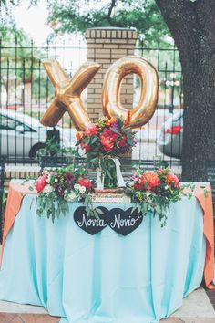 Add splashes of bright colors and fun balloons for a beautifully eclectic wedding table!