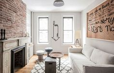 Living room of lovely New York apartment with brick wall Monochromatic Magic: Refined Rental Apartment in New York City