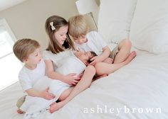 When incorporating siblings into a newborn session, understated outfits with neutral colors helps to keep the focus on baby... and, when there are lots of kids to coordinate, this makes it easy! www.ashleybrownphotography.com