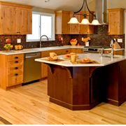 Love when designers use a different stain on the island than the rest of the kitchen Cabinets!