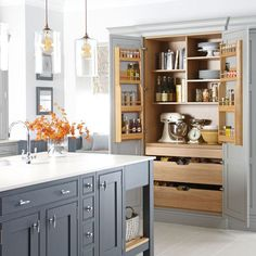 A place for everything and everything in it's place. Who wouldn't want to spend time in such a stunning (and organized) kitchen.