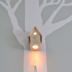 You could do this with a $5 birdhouse from a craft store and a light bulb. Fun way to create ambient lighting in your office.