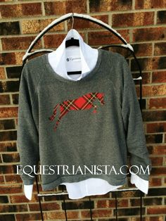 You will be the epitome of equestrian style in this vintage feeling sweatshirt with an Ivy League flavor!  Our plaid jumper artwork is an in-house creation, thus making this sweatshirt truly original. You will love wearing this feminine fitting, extra-wide collar sweatshirt to the barn, or dressed up for a day of shopping. Made of a perfectly broken in feeling fleece, it already feels like it's been in your closet forever.
