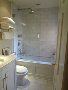 """Tiled shower. Larger tiles = less grout = less yuck. Marble veining = dirt disguise. Tile to ceiling = less drywall (yay!)    Hardware: Like finish. """"Rain-shower"""" + detachable shower head.    Glassed-in = no yucky shower curtain."""