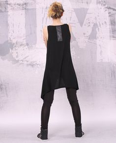 Asymmetrical black sleeveless tunic top.    If you prefer different length of the tunic please inform me.    I can make the tunic according to your