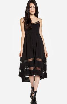 Pretty black dress. Love the length