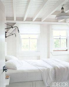 Inside Celebrity Homes Meg Ryan - Beach House Decor of Meg Ryan - ELLE DECOR sconces and white