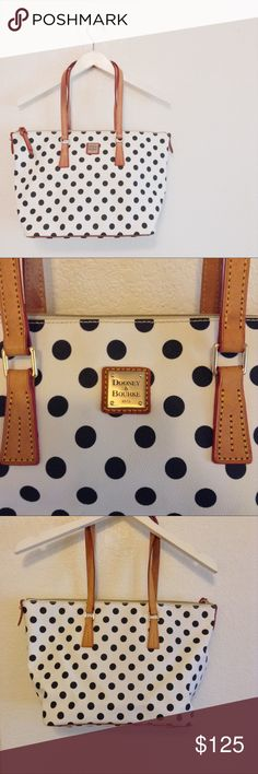 Dooney & Bourke Polka Dot Large Tote Excellent condition- there are some very small spots of discoloration on the back but they are very faint and very small. I have not tried to clean them off. The front of the bag is in perfect condition, the hardware has no scratches. The handles show no wear. The inside shows some signs on use- a little darkening, but no stains or tears. 100% authentic. Large size, black and white pattern. Questions are welcome 😊 Dooney & Bourke Bags Shoulder Bags