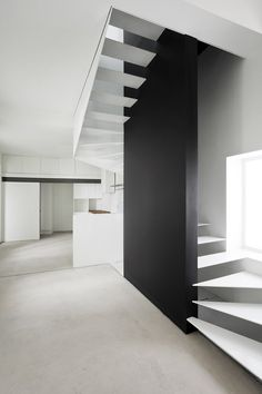 :: STAIRS :: The White House, Athens by Eleanna Horiti Architecture. lovely detail with the use of black for the center wall division, a great visual focal point that penetrates through the floor the floor plate