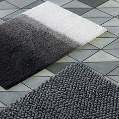 Plush and modern. With luxurious bath towels in rich colors and neutral shades, plus coordinating bath rugs, you can design a spa-like space for everyday use.