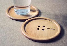 This giant wooden drink coaster by Taiwanese manufacturer BU-WU looks like a magnified shirt button.