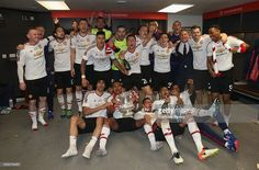 The Manchester United squad celebrates in the dressing room with the FA Cup trophy after The Emirates FA Cup final match between Manchester United and Crystal Palace at Wembley Stadium on May 21, 2016 in London, England.