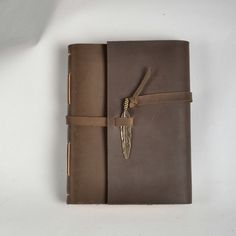 Leather journal handmade, leather notebook, vintage journal, unique travel diary, brown, with vintage feather,guest sign book,gift. $60.00, via Etsy.