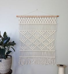 """macrame-triangles   Dowel is a 1""""x1"""" cherry hardwood that I sanded and oiled. Rope is 1/4"""" (6mm) braided cotton. This wall hanging was made using over 600 ft (180m) of rope! http://hollymuellerhome.com/shop/4ou5o1dhkgh0p6tu8m2vhwvj2yqp2p  DIMENSIONS Top of dowel to bottom of fringe: 48"""" Dowel width: 40"""" Weaving width: 36"""""""