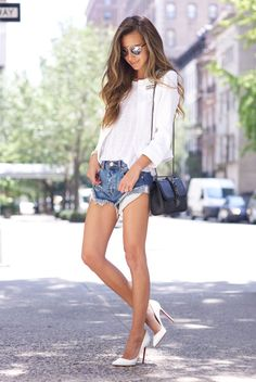 spring / summer - street style - street chic style - summer outfits - party outfits - raw hem denim shorts + white stilettos + white tee + white jacket + mirror sunglasses + black shoulder bag