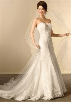 Strapless lace fit and flare gown with the sweetheart neckline and flared skirt have been accented throughout with timeless lace. The gown is finished with a semi-cathedral length train.