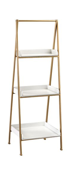 Bring a fresh and delicate boost to a living room or indoor patio with this Serrano Accent Shelf. Three tiers holding a trio of lovely white trays join in an easel-style frame finished in chic gold. Ma...  Find the Serrano Accent Shelf, as seen in the Industrial Iridescence Collection at http://dotandbo.com/collections/industrial-iridescence?utm_source=pinterest&utm_medium=organic&db_sku=113737