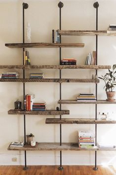 Modern reclaimed wood shelving unit is made from reclaimed wood and black pipes for an industrial home shelving display. With multiple shelves, storage will never be a problem. #industrialshelving Wood Shelving Units, Industrial Shelving, Industrial House, Wood Shelves, Shelving Display, Pipe Shelves, Glass Shelves, Storage Shelves, Floating Shelves
