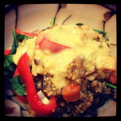 Quinoa and veggies over steamed spinach... Oh! With white bean curry sauce!
