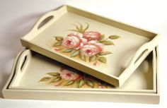 """A nested trio of wood trays will serve the wine, canapés, or Belgian waffles in bed. Each is graced with an artist's original version of pale, pink roses. Set of 3. Largest 16½ x 11 x 2"""""""