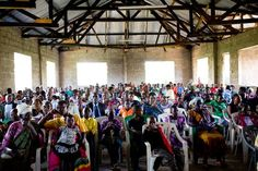 """""""There will just be a few families at the church who want to meet you,"""" Mary said. She's the cherub-faced woman with an easy smile who is our wise gude all week, on loan from Compassion's Tanzania office. And she lies. """"A few families,"""" she said. After two days of… Read More"""
