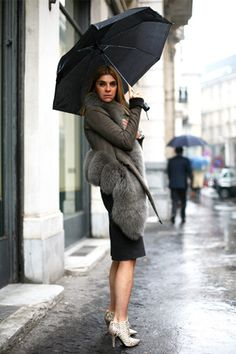 Carine Roitfeld In her closet: Givenchy, Tom Ford-era Gucci, Equipment Iconic look  Bare legs; teetering heels; big fur chubby; short, short dress; all black:...